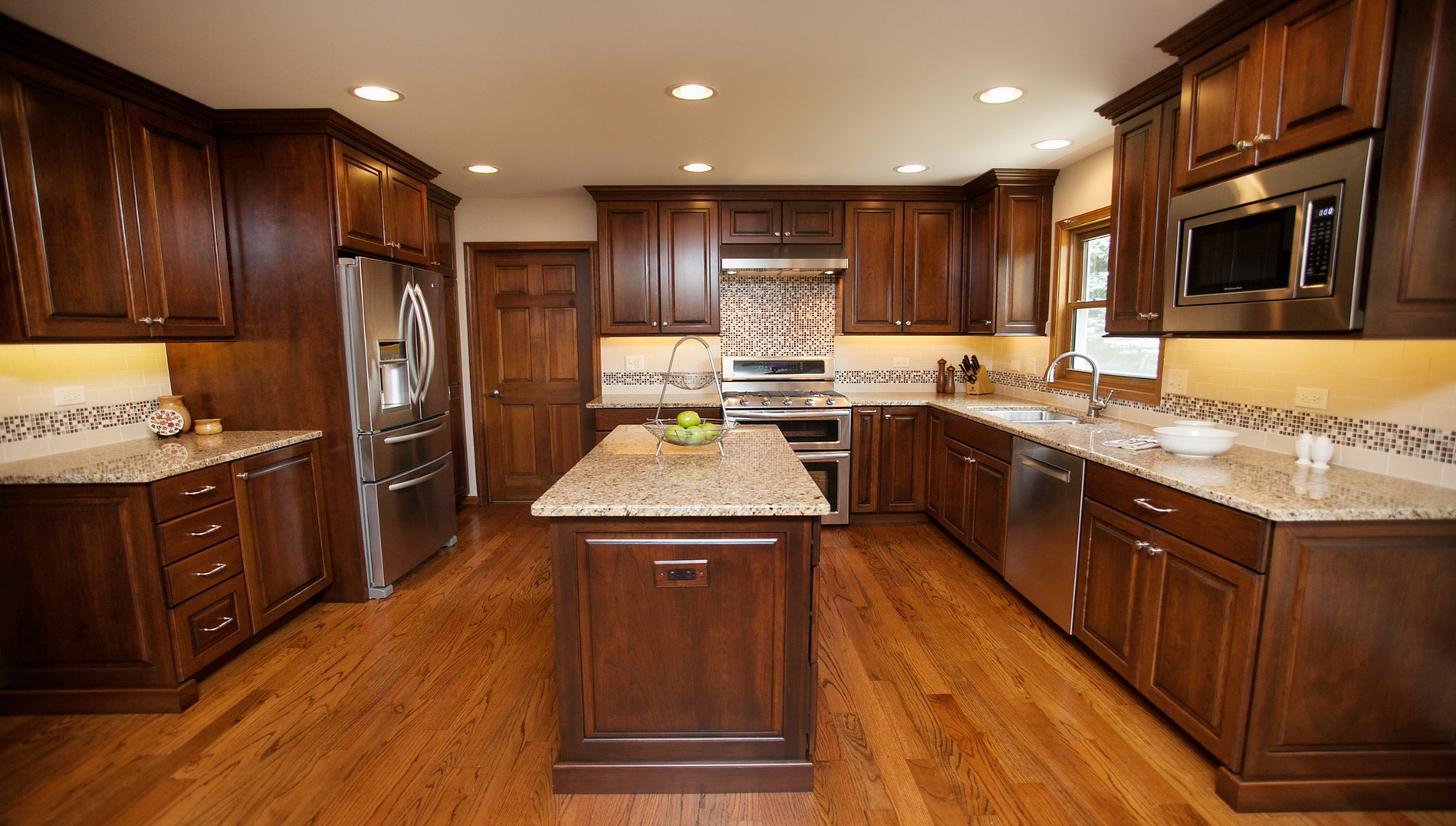 Dinner is served! This elegant kitchen boasts richly finished cherry