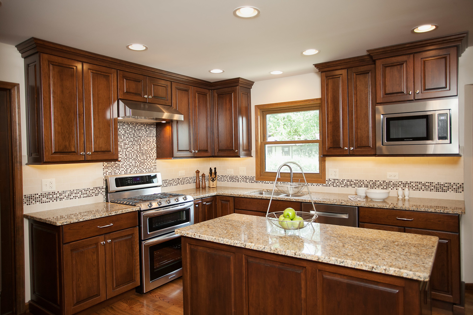Uncategorized Chinese Kitchen Design tempting traditional river oak cabinetry design light toned granite counter tops porcelain back splash tile and accent with glass stone add stylish finishing touches to this traditional