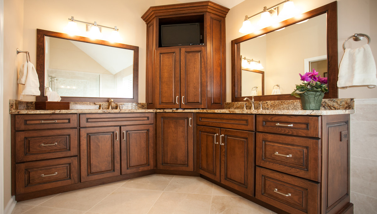 Beautiful double vanity with center shared storage.  The tower cabinet features a lazy susan below, large shelf storage behind the doors and open storage specifically for a television.  The vanities are topped with Lapidus granite.