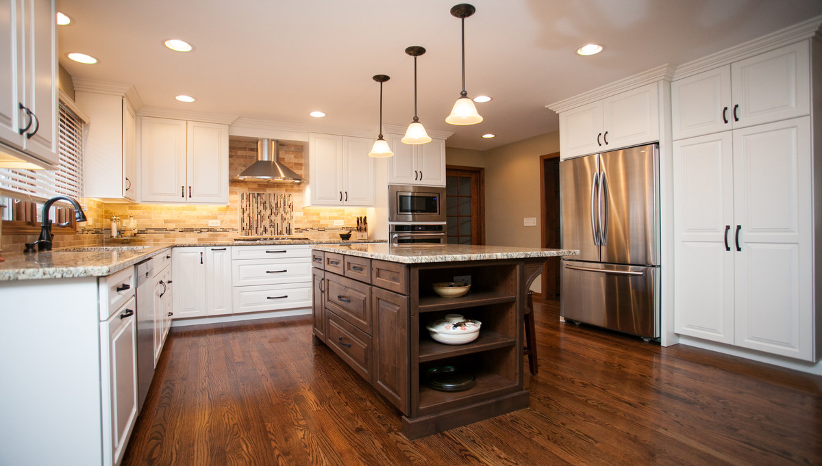Two toned kitchen in painted maple and stained hickory.  Medium stain on wood floors.