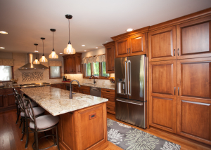 Amish custom cabinetry sets the tone in this gorgeous kitchen.  Rich maple stain on maple cabinetry IS the focal point.