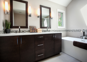 Expansive contemporary vanity in rich stain with tremendous storage.