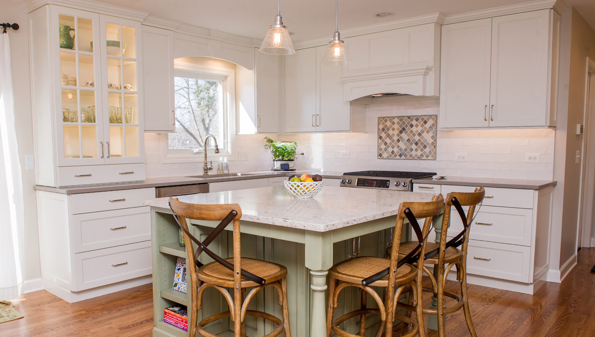 Light bright and beautiful! All white Amish custom cabinetry with contrasting island opens up to family room.