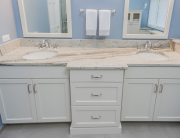 Large custom vanity in Maple cabinetry with a painted finish.  The vanity is topped with River White granite.