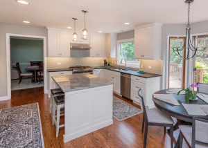 The overall look of the kitchen is light and bright.  The white cabinetry replaced oak cabinets that were much the same color as the current floor.  Soffits were removed along with an expansive florescent light fixture that dominated the working area of the kitchen.