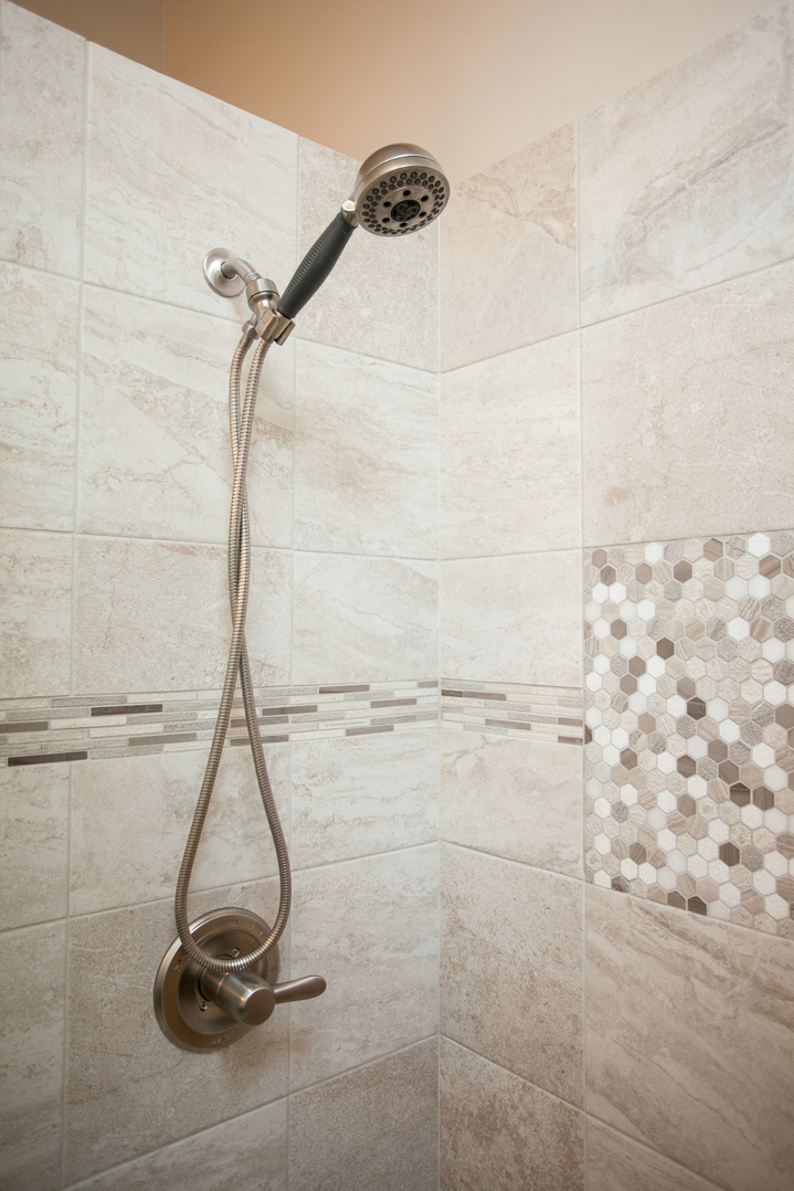traditional a shower to this tiles pin trim features ceiling the patterned accent from near extends blue mounted white tile head for large