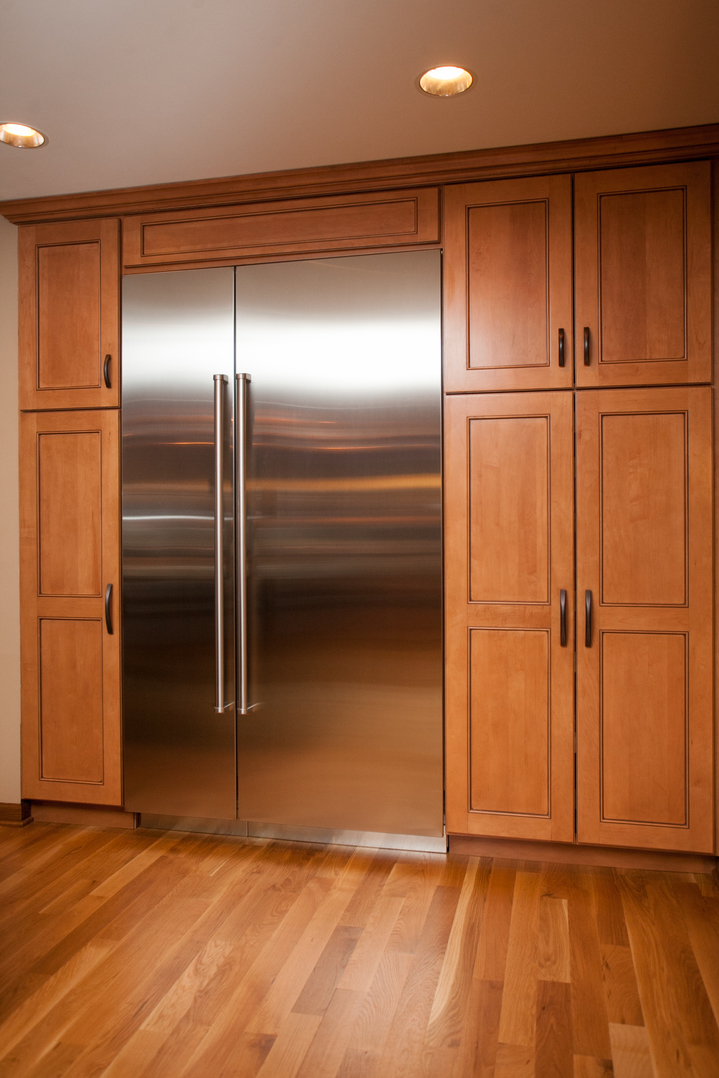 The Refrigerator Is Built In And Surrounded With Large Floor To Ceiling  Cabinetry. The Lower Pantry Cabinets Are Outfitted With Roll Out Shelves  For ...