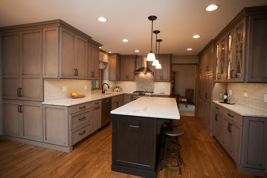 """The 'greige' cabinetry is warm and inviting.  The left side of the picture illustrates the built in, 'found storage' where we added an 8"""" deep, floor to ceiling cabinet in the eating area."""